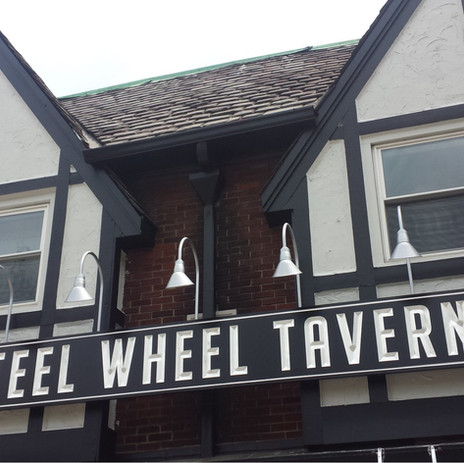 Steel Wheel Tavern - carving sign