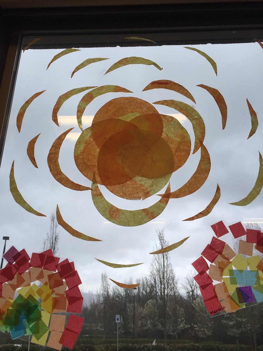 Laminated paper circle sunshine, raindrops and rainbows make beautiful window display from both sides.
