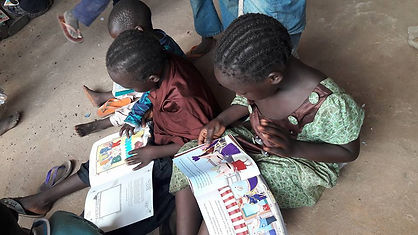 Children reading our donated Books in an IDP Camp in Nigeria