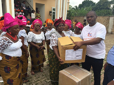 Women receiving donated reproductive health items from DKT Nigeria