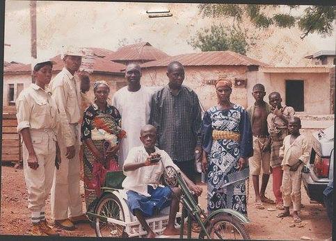 Donating the trycycle to Shadrack Abu