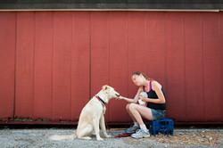 Homeless woman and dog eating