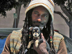 Homeless man and puppy