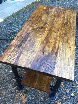 Reclaimed floorboards from a horse barn table