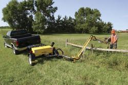 Small trailer mounted valve exerciser over a fence
