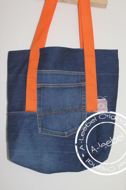 Tas van jeans met oranje hengsel