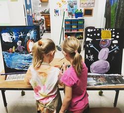 Sisters painting winter scenes