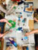 Kids painting wood sculptures in children's art studio