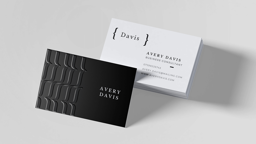 A stack of black and white business cards with spot uv detailing.