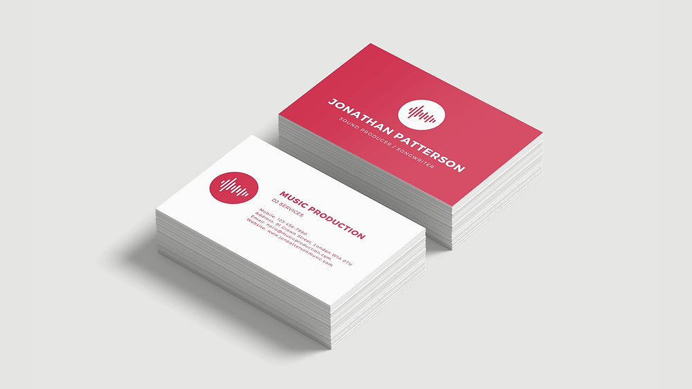 Two stacks of pink with white writing and white with pink writing soft touch business cards.