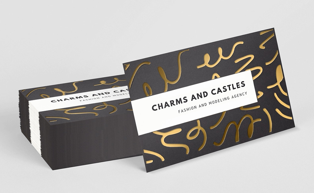 Business cards with gold foiling details.