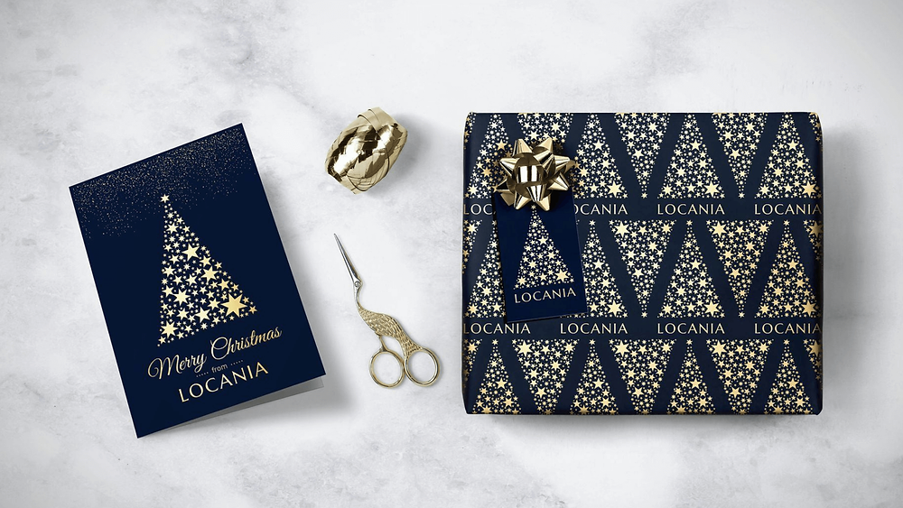 Branded Christmas wrapping paper and greetings card.