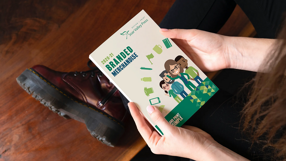 Person Holding a Branded Merchandise Brochure