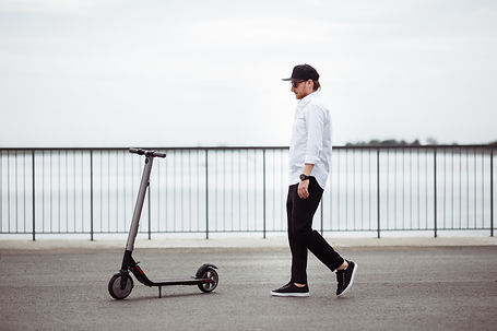 photo-of-modern-man-with-electric-scoote