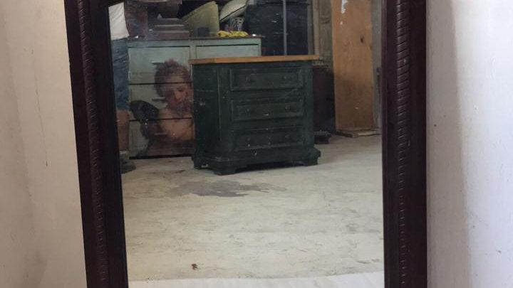 Espejo con detalle en metal forjado