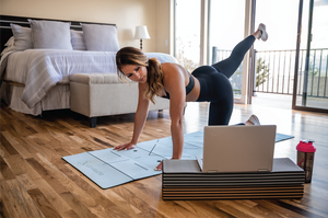 Fitness mats,girl doing workout,home workout