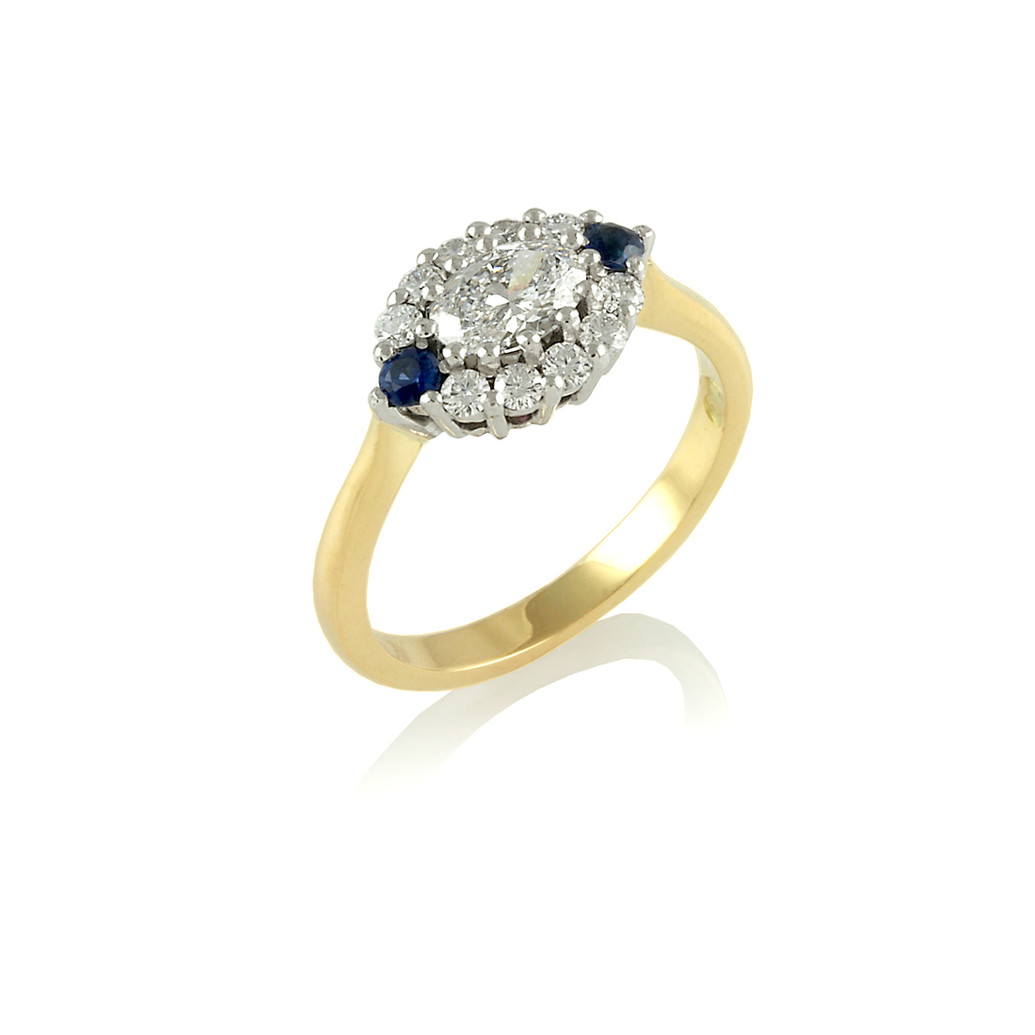 Oval Diamond cluster ring with Sapphires