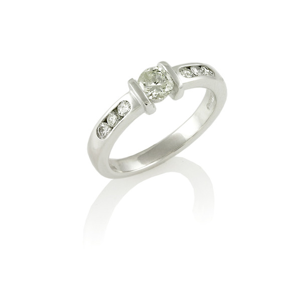 Bar set Diamond solitaire ring with channel set shoulders