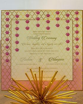Contemporary lotus and lattice wedding invitation bangalore