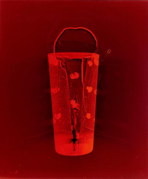 "Entrance (Red Hearts). Colour photogram of lipped glass spilling liquid.Unique colour photogram on lustre paper. 10""x12"". 2020"