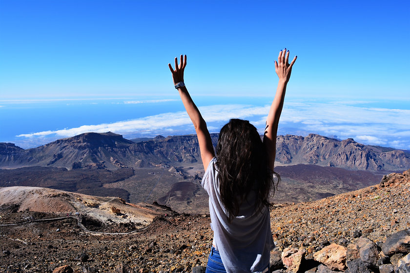 Canva - Woman Standing on Mountain While