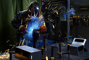 Industrial Worker labourer at the factory welding steel structurewelder is welding metal part in car