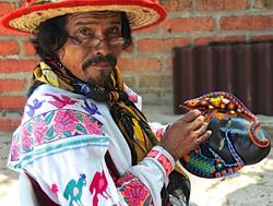 commercial artisan huichol bead man