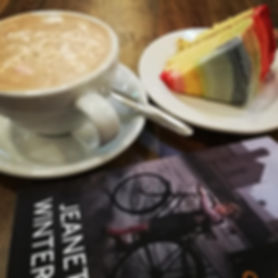 Book, hot chocolate and rainbow cake.jpg