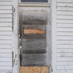 Door boarded up