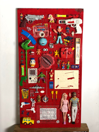 """Life Tools is a playful exploration into the """"tools"""" that are actually important in life - our capacity to be playful, open and not take ourselves too seriously.The work is composed of toys and drawings of toys that were popular in the 80's and displayed on an aluminium tool organizer.    Dimensions:80 cm X 134 cm X 15 cm  Medium: Metal Paint drawings and collected Toys on Aluminium  """