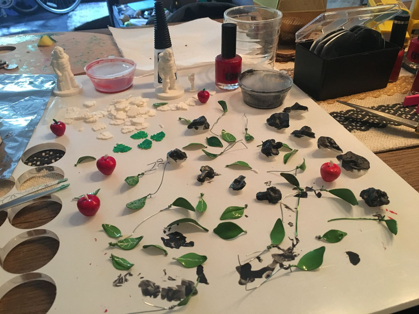 Art Process. 3D Printed Apples , Smoothing, Painting and Coating.  More than 1,000 leaves handmade with slim iron wire and curved into a leaf using wood, glue and paint.