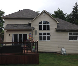 beige house with back deck