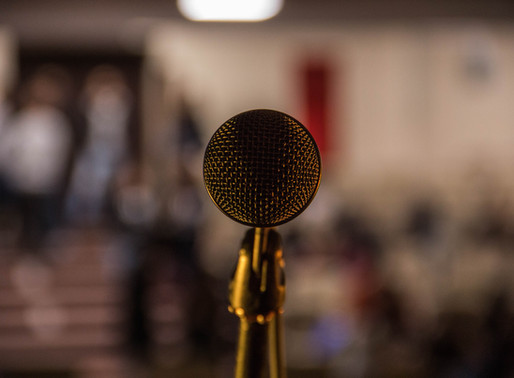 In the Spotlight: Poetry Open Mic Night Experiences
