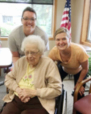 Senior with smiling employees