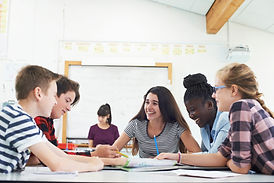 Group Of Teenage Students Collaborating