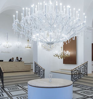 This beautiful traditional crustal oversized chandelier is decorating the hallway of a commercial property