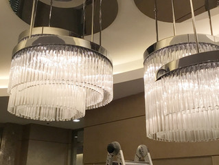Cleaning oversized chandelier at the Lobby. Commercial project. Ocean front. Miami, Florida