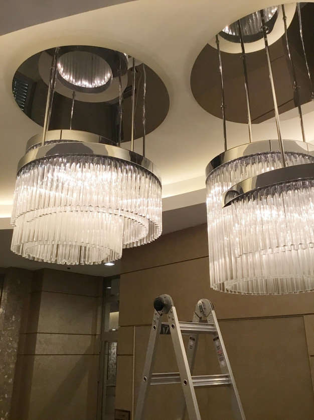 Cleaning Oversized Chandelier At The Lobby Commercial