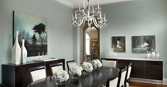 Contemporary crystal chandelier over the dining room table provides enough light to lit up the room and allows for a friendly and receptive atmosphere for anyone who dines beneath.