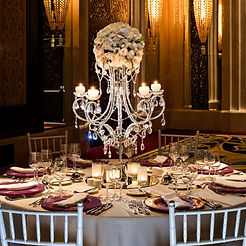 A crystal chandelier over a dining table. Traditional design symbolises warmth, reception, passion, legacy and style.
