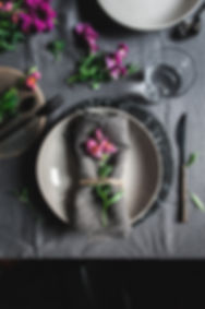 dark mood photography, table set up, pink flowers