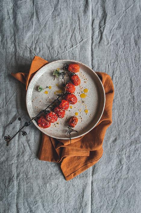 minimal food photography, natura linen, roasted cherry tomatoes, handmade ceramic