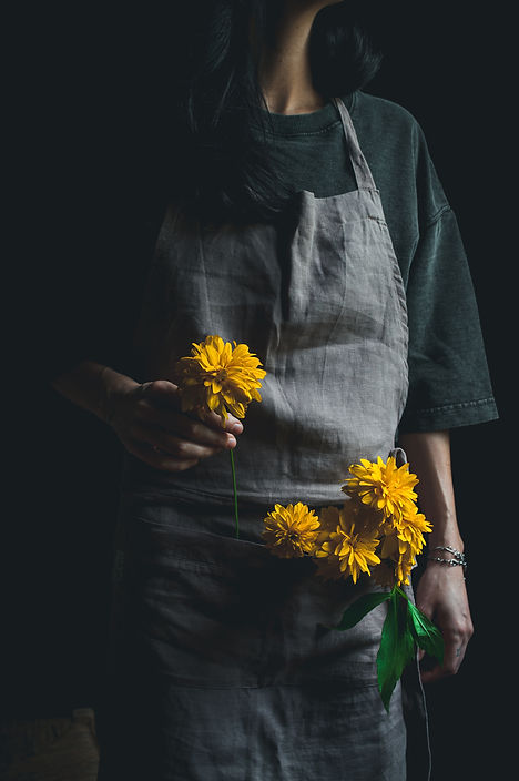 dark mood photography, yellow flowers