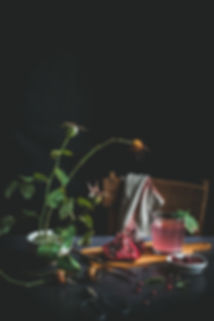dark mood food photography, still life, pomegranate