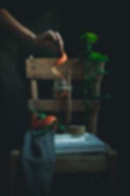 dark mood food photography, tea time, green leaves, orange peels