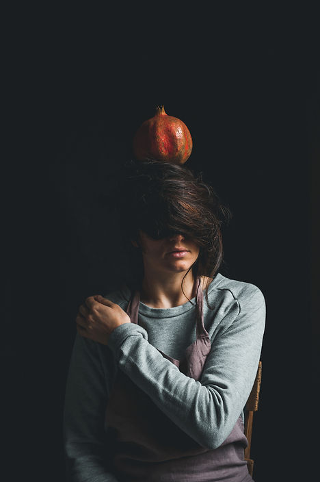 girl with pomegranate, natural light portrait, dark mood photography