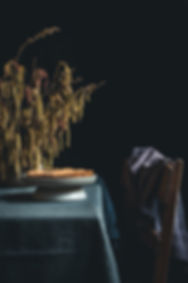 dark mood food photography, plump tart, hazel flowers