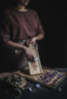 dark mood food photography, purple potatoes, linen apron