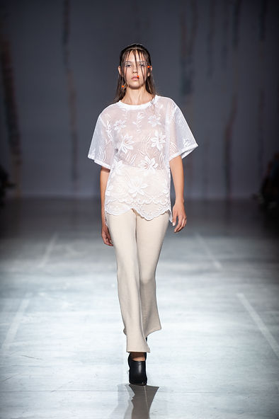 MASHAT SS20 Collection - UFW fashion show. Look 12: model dressed in white Tulle-shirt with decorative hem and nude knit pants on an elastic ribbon