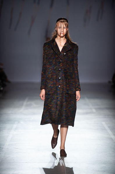 MASHAT SS20 Collection - UFW fashion show. Look 8: model dressed in deconstructed wool coat with blurred print